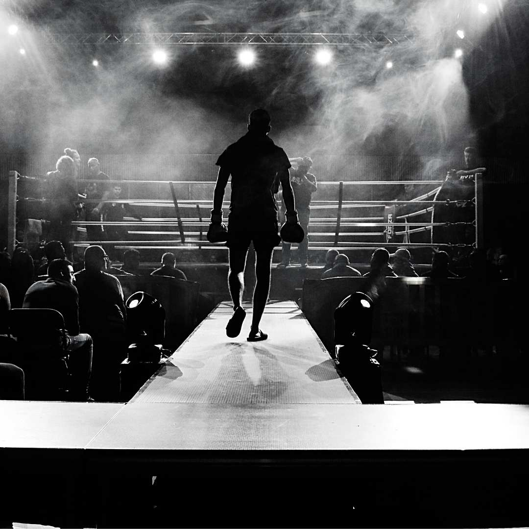 contract-negotiations boxer entering ring
